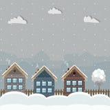 Casas de madera coloridas, tema del invierno Imagen de archivo libre de regalías