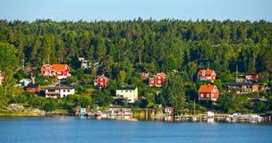 Casas de madera rojas Foto de archivo libre de regalías
