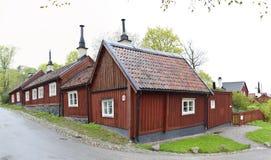 Casas de madera rojas viejas en Estocolmo Fotografía de archivo libre de regalías