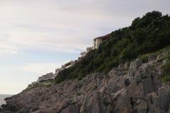 Casas de pedra na rocha Foto de Stock