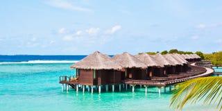 Casas de planta baja del agua en Maldives Imagen de archivo libre de regalías