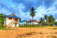 Casas de vacaciones en polos en la salida del sol Imagen de archivo libre de regalías