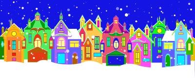 Casas del invierno con la decoración de la Navidad Imágenes de archivo libres de regalías