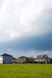 Casas destacadas do terreno de construção Imagem de Stock