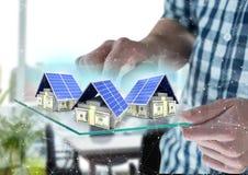 3 casas do dinheiro no dispositivo futurista foto de stock royalty free