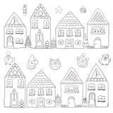 Casas do Natal com o símbolo do ano novo ilustração royalty free