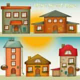 Casas dos desenhos animados ajustadas Fotografia de Stock Royalty Free