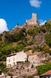Casas e torre de cidade em Lastours Imagens de Stock Royalty Free