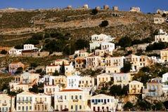 Casas em Yalos, o porto de Symi imagens de stock royalty free