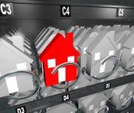 Casas en el hogar único de sobra de las propiedades inmobiliarias de la máquina expendedora Fotografía de archivo libre de regalías