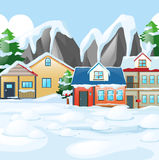 Casas en el pueblo cubierto con nieve stock de ilustración