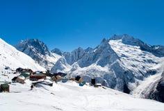 Casas en el top de montañas Foto de archivo libre de regalías