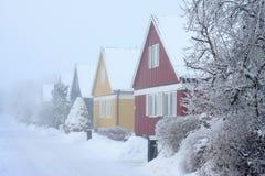 Casas en frialdad de los inviernos Fotografía de archivo libre de regalías
