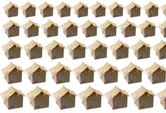 Casas feitas de cinqüênta notas de banco avaliadas Fotografia de Stock Royalty Free