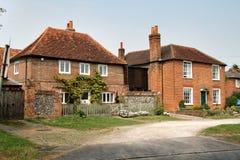 Casas inglesas da vila Fotos de Stock Royalty Free