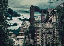 Casas medievales del estilo de la escena oscura foto de archivo