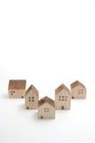 Casas miniatura en el fondo blanco Imagen de archivo libre de regalías