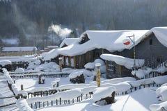 Casas nevadas Imagen de archivo libre de regalías