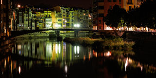 Casas penjades, Girona, Spain. Reflections of colorful houses at night in Girona, Spain Royalty Free Stock Photo