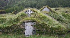 Casas resistidas del césped Imagen de archivo libre de regalías