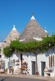 Casas tradicionales de Trulli Fotos de archivo libres de regalías