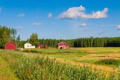 Casas vermelhas em uma paisagem rural Fotografia de Stock Royalty Free
