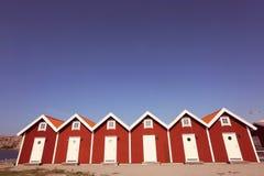 Casas vermelhas idênticas Foto de Stock Royalty Free