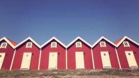Casas vermelhas idênticas Fotografia de Stock Royalty Free