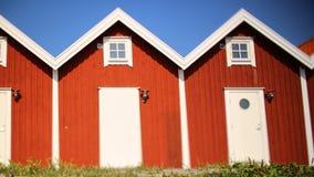 Casas vermelhas idênticas Foto de Stock
