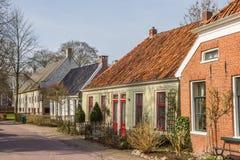 Casas viejas en una calle en Oudeschans Fotografía de archivo libre de regalías