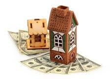 Casas y dólares foto de archivo