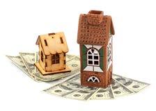 Casas y dólares imagen de archivo