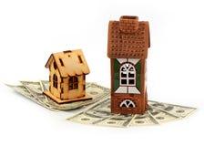 Casas y dólares fotos de archivo