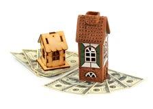 Casas y dólares imagenes de archivo