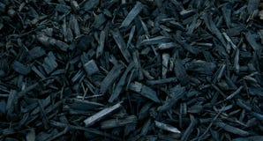 Casca decorativa preta da palha de canteiro Imagens de Stock