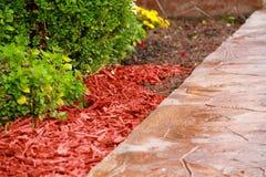 Casca decorativa vermelha da palha de canteiro Fotografia de Stock