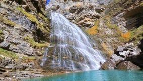 Cascada Cola de Caballo waterfall under Monte Perdido at Ordesa stock video footage