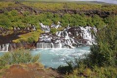 Cascada de Hraunfossar en Islandia Foto de archivo