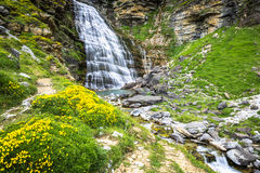 Cascada de la Cueva waterfall in Ordesa valley Pyrenees Huesca S. Pain Arazas river Royalty Free Stock Photo