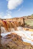 Cascada en el área minera de Riotinto, Andalucía, España Fotos de archivo
