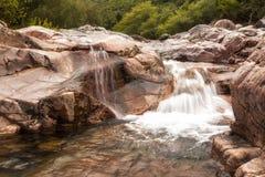 Cascada en el valle de Fango en Manso en Córcega Imágenes de archivo libres de regalías