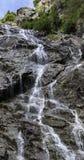 Cascada en las montañas Imagen de archivo libre de regalías
