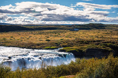 Cascada en verano, Islandia de Faxi Imagen de archivo