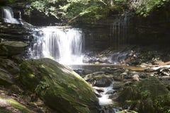 Cascada Sunlit Imagen de archivo libre de regalías