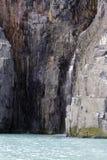 Cascade à écriture ligne par ligne de bas de glacier Images libres de droits