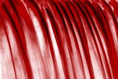 Cascade à écriture ligne par ligne rouge image stock
