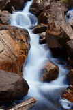 Cascade. Water on rocks royalty free stock photo