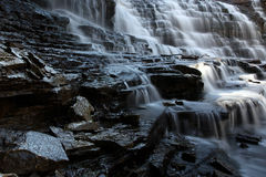 Cascade. Waterfall and rocky gorge Stock Images