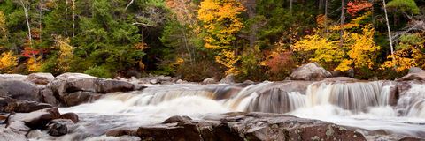 Cascade and Autumn Colors. Panoramic View of Cascade with Fall Foliage royalty free stock photos