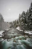 Cascade Bliss. The Chilliwack River flows through the wintery landscape at the foot of Mt. Cheam in the Fraser Valley.  Chilliwack, BC, Canada Royalty Free Stock Photography
